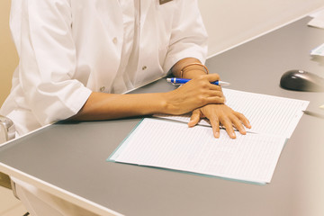 Female Doctor Taking Notes on Paper