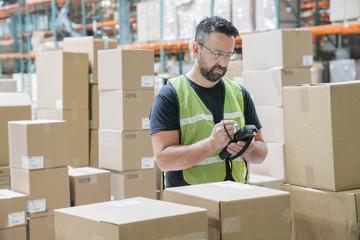 Warehouse worker using hand held scanner