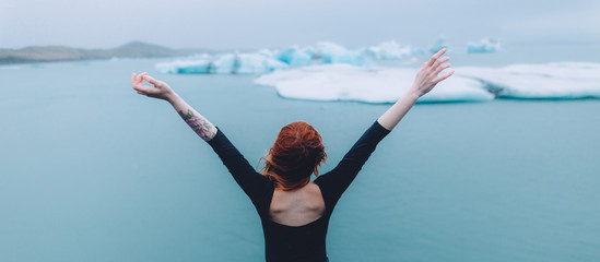 portrait of a woman in font of the glacier lagoon in iceland