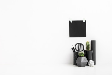 Black, white home, office, workspace with stationery and cactussses