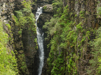 Braemore, Scotland - June 8, 2012: Closeup of waterfall of Corrieshalloch Gorge, a deep cut in landscape with forested vertical slopes. Landscape photo.