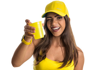 Brazilian woman fan celebrating on soccer match on white background.