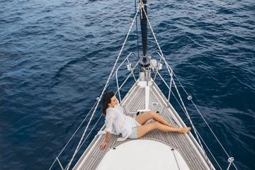 Woman Enjoying Vacation on Sailboat