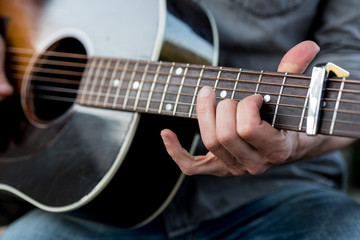 Detail of a musician playing a guitar
