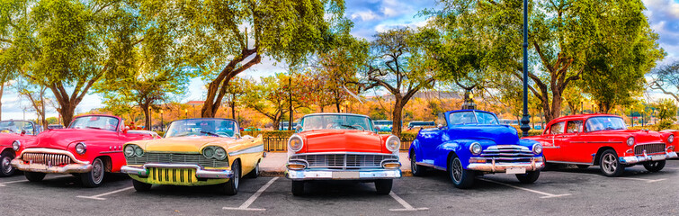 Colorful group of classic cars in Old Havana, an iconic sight in Cuba Wall mural