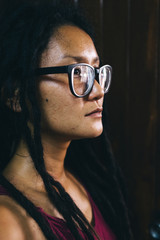 Profile of Thai Woman With Dreadlocks and Glasses