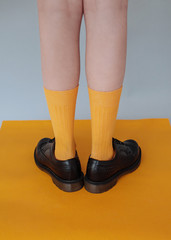 Legs of woman in bright yellow socks