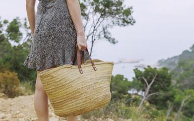 Woman watching the sea on an idyllic Mediterranean coast in the summertime