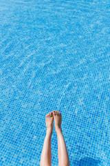 Legs at blue pool