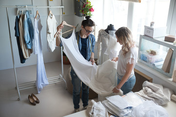 Tailor showing gown to client