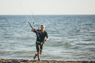 Kitesurfer Holding Control Bar