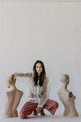 Woman Posing with Mannequins
