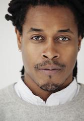 Close cropped portrait of a confident black man.
