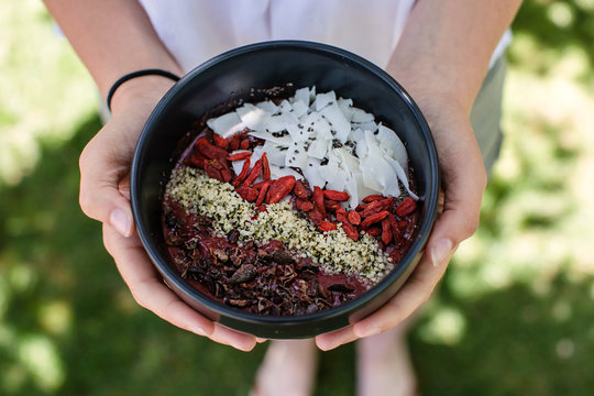 Healthy acai bowl  with coconut, goji berries, cacao nibs and other toppings
