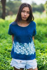 Portrait of a woman wearing shibori pattern top