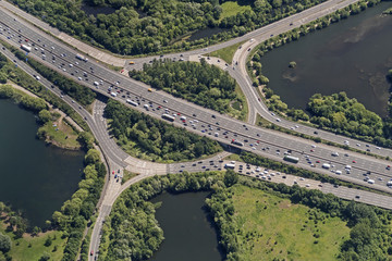 Circular motorway intersection in England seen from an airplane