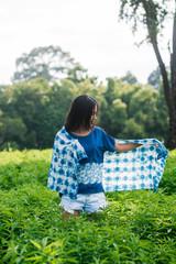 Asian woman wearing Shibori natural indigo clothes