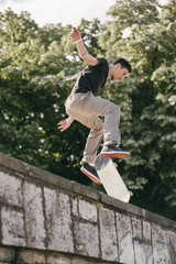 Young man performing a skate trick