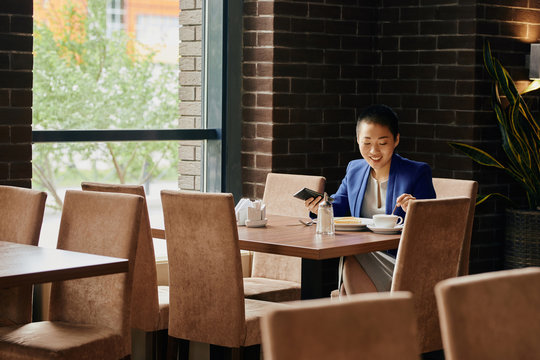 Portrait of Asian Businessman at Lunchtime