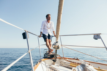 Man relaxing on sailboat.