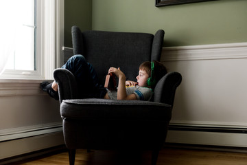 little boy on electronic device / tablet