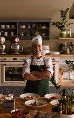 Cheerful cook with dishes