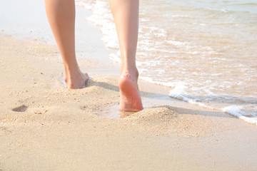 Women walk on the beach by the sea in the morning