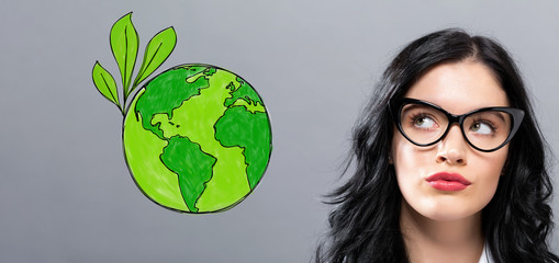 Green Earth with young businesswoman in a thoughtful face