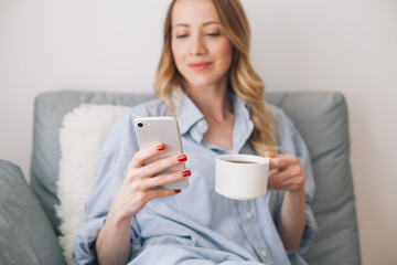 Woman browsing on her mobile phone indoor