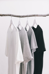 Grey scale of t-shirts.