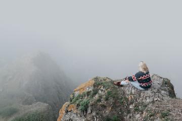 Anonymous woman posing in fog