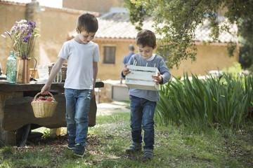 Family life, children preparing breakfast in the garden.