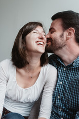A young engaged couple at home