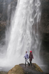 Two happy young women travelling in iceland