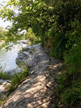Path next to a natural outdoors pool in Austin Texas (USA)