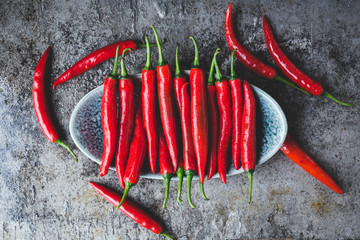 Red chillies on the dark background