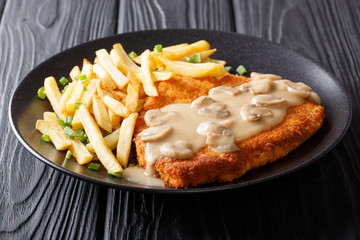 Crispy Fried Pork Chops (Jaeger Schnitzel) with sauce and french fries close-up. Horizontal