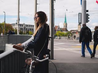 Girl near river in historic center of european city.