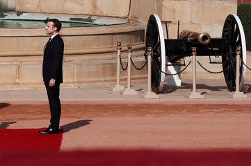 French President Emmanuel Macron inspects an honour guard during his ceremonial reception in New Delhi
