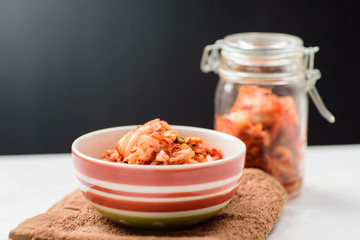 Kimchi cabbage (Korean food) in a bowl and jar