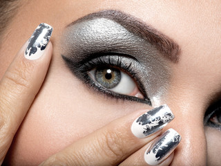 Beautiful girl with the silver makeup and nails.