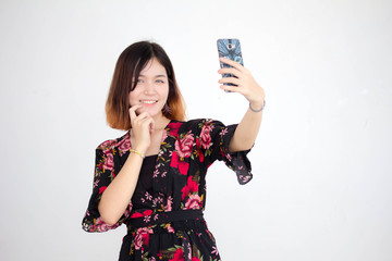 Portrait of thai adult beautiful girl short hair using her smart phone Selfie
