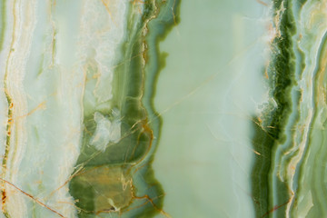 Photo sur Aluminium Marbre Beautiful green onyx texture with contrast surface.