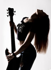 silhouette of rock woman playing on electric guitar on a white background.