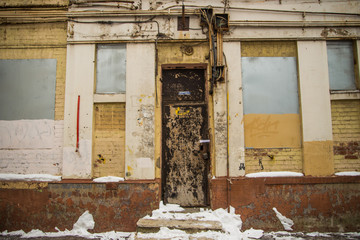 ramshackle entrance in an old high-rise building