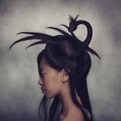 Girl with creative dragon hairstyle