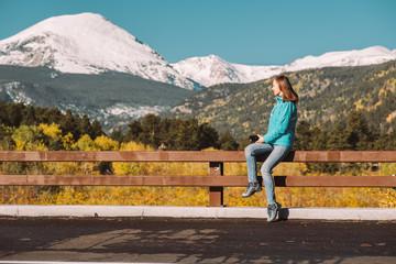 Tourist taking photo in Rocky Mountains at autumn, Colorado, USA.
