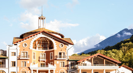 Image of buildings at foot of mountains