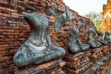Wall Mural - Buddha statue at Ayutthaya Historical Park, Wat Chaiwatthanaram Buddhist temple in Thailand.