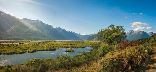 Glenorchy Lagoon panoramic view with the mountain range towards Mount Aspiring National Park in the background in New Zealand